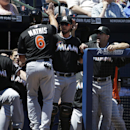 Miami Marlins' Jeff Mathis, left, is high-fived by teammate Jarrod Saltalamacchia after scoring off a double by Giancarlo Stanton in the sixth inning of a baseball game against the Atlanta Braves, Wednesday, April 23, 2014, in Atlanta The Associated Press