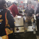 An injured crew member receives medical attention after a fire on pit road during the NASCAR Xfinity series auto race at Richmond International Raceway, in Richmond, Va., Friday April 24, 2015. (Skip Rowland/Richmond Times-Dispatch via AP)