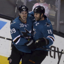 In this photo provided by SFBay, San Jose Sharks Joe Thornton (19) and Logan Couture (39) celebrate Thornton's goal against the St. Louis Blues during the first period of an NHL hockey game on Friday, Nov. 29, 2013, in San Jose, Calif The Associated Press