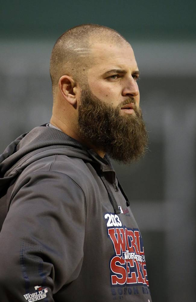 Boston Red Sox's Mike Napoli watches batting practice before Game 1 of baseball's World Series against the St. Louis Cardinals Wednesday, Oct. 23, 2013, in Boston