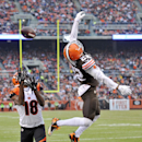 Cleveland Browns cornerback Buster Skrine (22) breaks up a pass to Cincinnati Bengals wide receiver A.J. Green (18) in the third quarter of an NFL football game Sunday, Dec. 14, 2014, in Cleveland The Associated Press