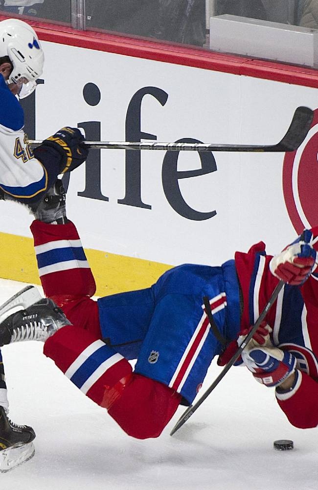 Montreal Canadiens' Douglas Murray, right, is knocked over by St. Louis Blues' David Backes during the first period of an NHL hockey game in Montreal, Tuesday, Nov. 5, 2013