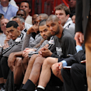 Tony Parker #9 and Tim Duncan #21 of the San Antonio Spurs look on from the bench during Game Two of the 2013 NBA Finals against the Miami Heat on June 9, 2013 at American Airlines Arena in Miami, Florida. (Photo by Andrew D. Bernstein/NBAE via Getty Images)