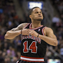 Chicago Bulls' D.J. Augustin celebrates after scoring against Toronto Raptors in the last two minutes during the second half of an NBA basketball game, Wednesday, Feb. 19, 2014 in Toronto The Associated Press