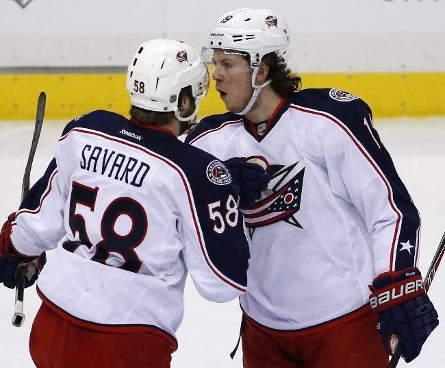 Columbus Blue Jackets' Ryan Johansen (19), right, celebrates his goal with teammate David Savard (58) during the first period of a first-round NHL playoff hockey game against the Pittsburgh Penguins in Pittsburgh Saturday, April 19, 2014