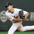 Japan's starter Shohei Otani pitches against MLB All-Stars during Game-5 of their exhibition baseball series at Sapporo Dome in Sapporo, northern Japan, Tuesday, Nov. 18, 2014. (AP Photo/Kyodo News)
