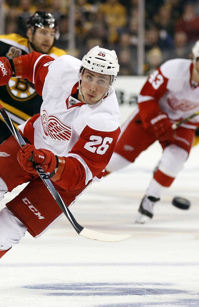 Detroit Red Wings' Tomas Jurco chases down a loose puck against the Boston Bruins during the first period of Game 1 of a first-round NHL playoff hockey series in Boston on Friday, April 18, 2014