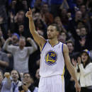 Golden State Warriors' Stephen Curry celebrates a score against the Dallas Mavericks during the second half of an NBA basketball game Wednesday, Dec. 11, 2013, in Oakland, Calif. (AP Photo/Ben Margot)