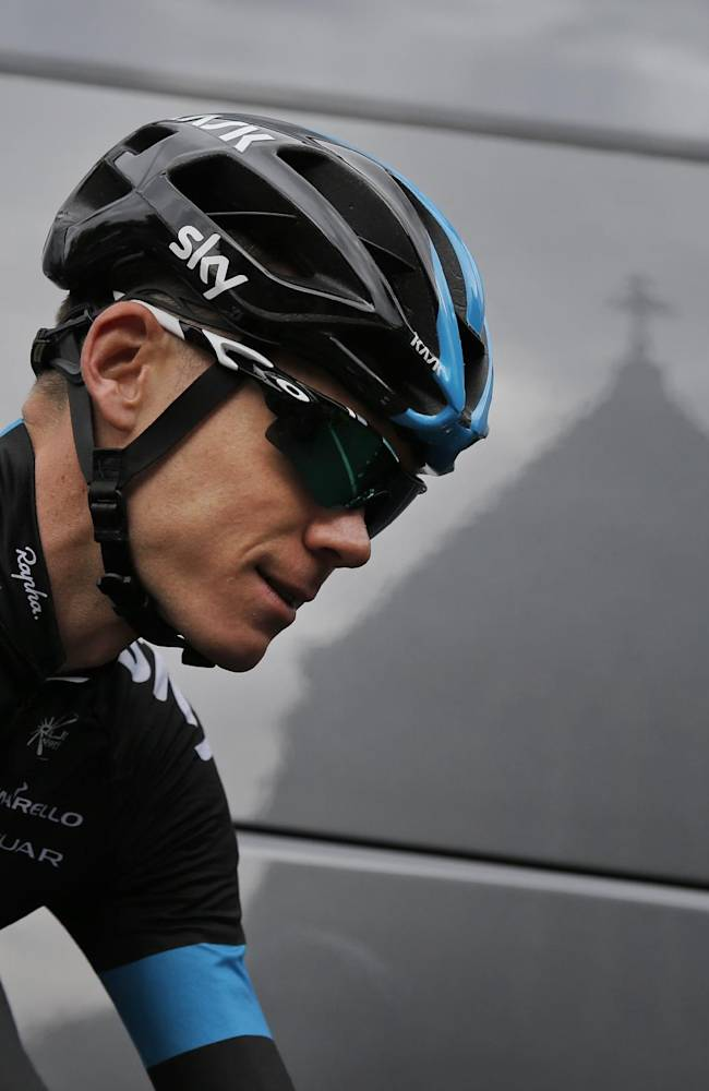 A chapel on the hotel premises is reflected in the Sky team bus as Britain's Christopher Froome prepares to leave for a a training ride ahead of the Tour de France cycling race in Leeds, Britain, Thursday, July 3, 2014. The Tour de France will start on Saturday July 5 in Leeds, and finishes in Paris on Sunday July 27