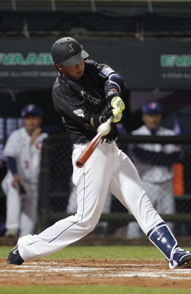 Japan's Hideto Asamura flies to right against Taiwan in the second inning of their exhibition baseball game at the Xinzhuang Baseball Stadium in New Taipei City, Taiwan, Friday, Nov. 8, 2013