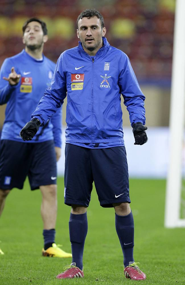 Greece's defender Vassilis Torosidis speaks with his teammates during a training session at the National Arena in Bucharest, Monday, Nov. 18, 2013. The Greek national soccer team will play Romania in their World Cup qualifying playoff second leg match on Tuesday