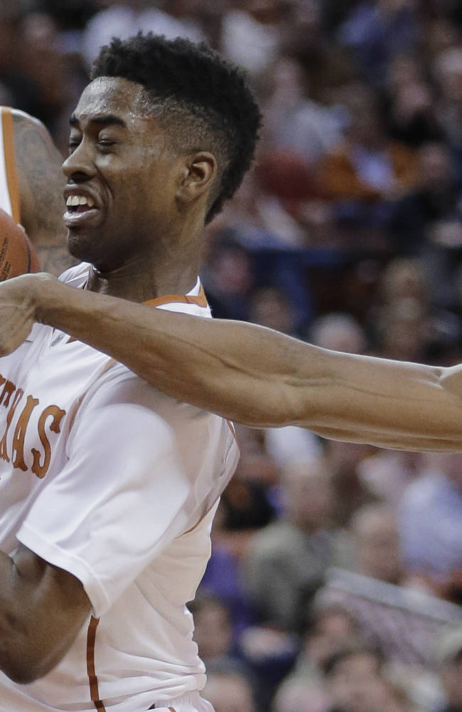Texas' Isaiah Taylor (1) tries to protect the ball from Oklahoma State's Markel Brown during the first half on an NCAA college basketball game, Tuesday, Feb. 11, 2014, in Austin, Texas