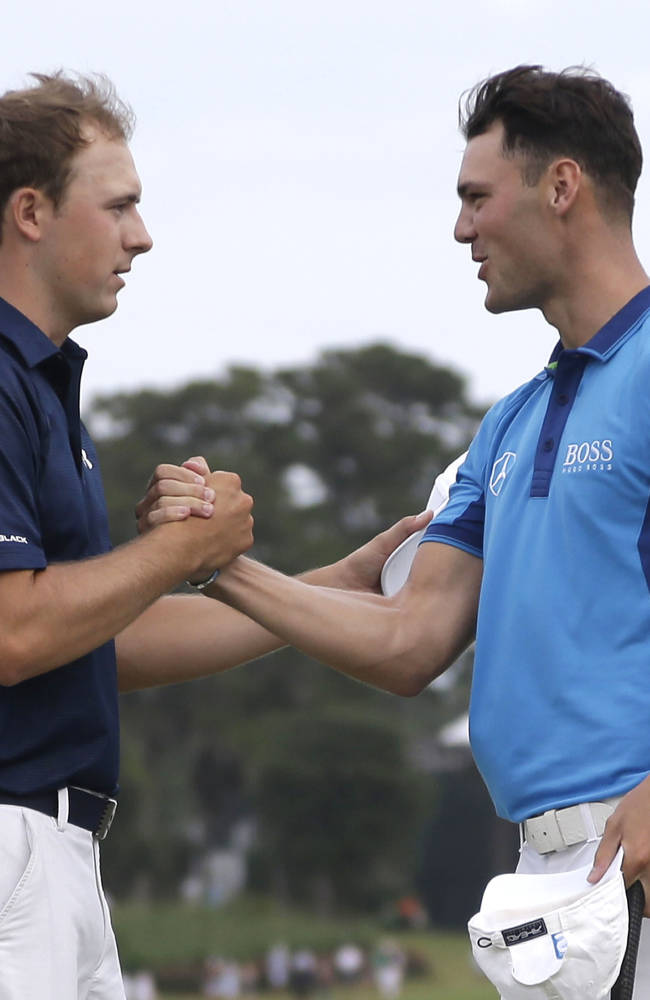 Jordan Spieth, left, and Martin Kaymer of Germany, shake hands at the end of the third round of The Players championship golf tournament at TPC Sawgrass, Saturday, May 10, 2014 in Ponte Vedra Beach, Fla
