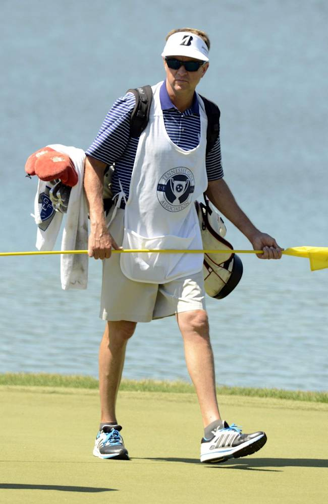 PGA golfer Davis Love III caddies for his son, Davis Love IV, during the Southern Amateur Championship golf tournament Wednesday, July 16, 2014, at the Honors Course in Ooltewah, Tenn