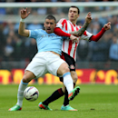 Sunderland's Adam Johnson, right, vies for the ball with Manchester City's Aleksander Kolarov, left, during their English League Cup final soccer match at Wembley Stadium, London, England, Sunday, March 2, 2014