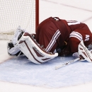 Arizona Coyotes' Devan Dubnyk dejectedly kneels on the ice after giving up a goal to Minnesota Wild's Mikko Koivu, of Finland, during the shootout of an NHL hockey game Saturday, Dec. 13, 2014, in Glendale, Ariz. The Wild defeated the Coyotes 4-3 in a sh