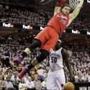 Los Angeles Clippers' Blake Griffin (32) hangs on the basket after dunking over Memphis Grizzlies' Zach Randolph (50) during the first half in Game 1 of a first-round NBA basketball playoff series, Sunday, April 29, 2012, in Memphis, Tenn. (AP Photo/Danny Johnston)