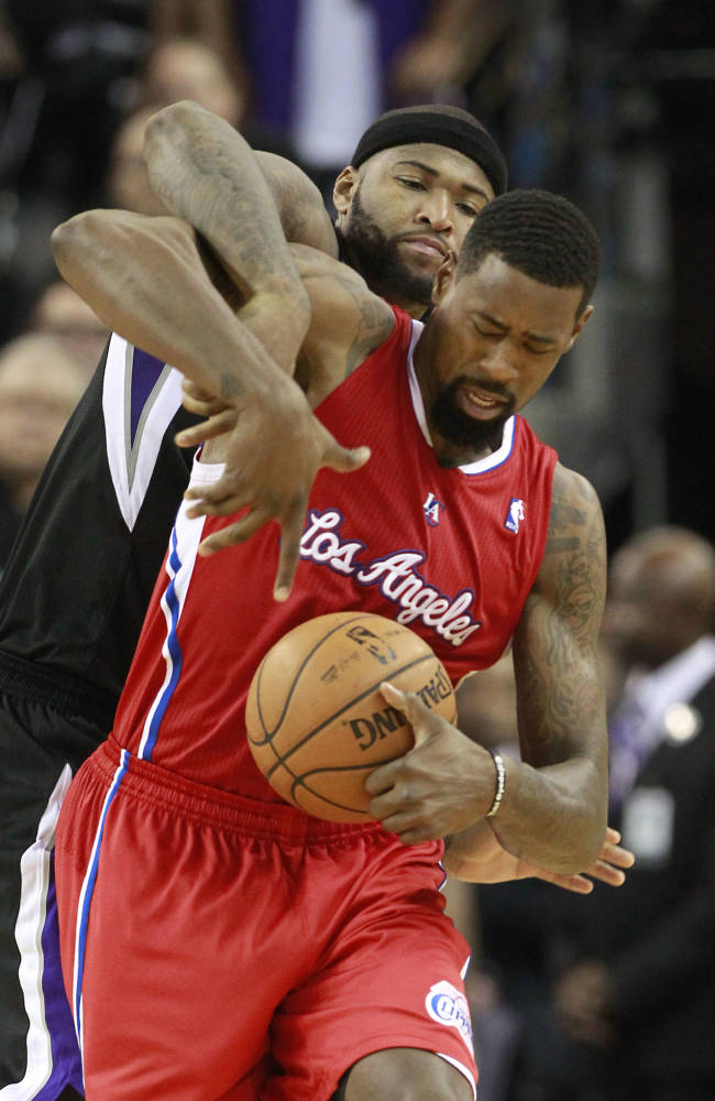 Los Angeles Clippers center DeAndre Jordan, right, protects the ball from Sacramento Kings center DeMarcus Cousins during the fourth quarter of an NBA basketball game in Sacramento, Calif., Friday, Nov. 1, 2013. The Clippers won 110-101