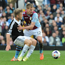Aston Villa's Marc Albrighton, right, and Southampton's Luke Shaw battle for the ball during the English Premier League soccer match between Aston Villa and Southampton at Villa Park, in Birmingham, England, Saturday, April 19, 2014