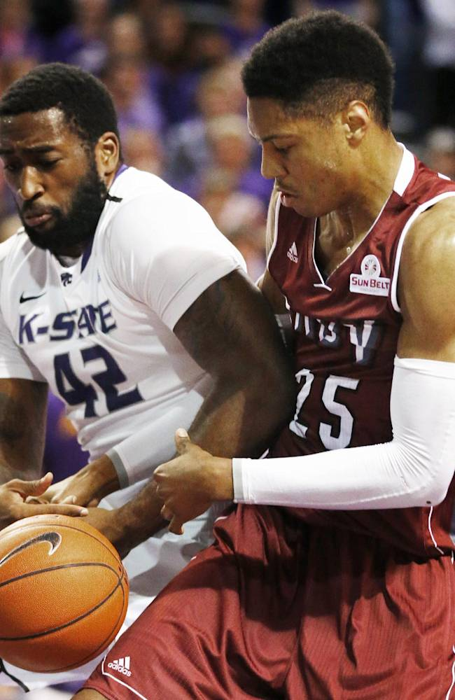 Kansas State forward Thomas Gipson (42) and Troy forward Kevin Thomas (25) struggle for control of the ball during the first half of an NCAA college basketball game at Bramlage Coliseum in Manhattan, Kan., Sunday, Dec. 15, 2013