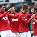 Manchester United's Juan Mata, right, celebrates his goal with his teammates during their English Premier League soccer match against Newcastle United at St James' Park, Newcastle, England, Saturday, April 5, 2014