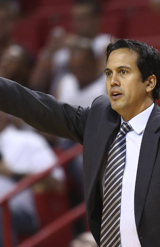 Miami Heat coach Erik Spoelstra yells instructions to his team during the second half of an NBA basketball game against the Washington Wizards in Miami, Sunday, Nov. 3, 2013. The Heat won 103-93