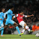 Arsenal s Theo Walcott, right, shoots at goal during the Group F Champions League soccer match between Arsenal and Marseille at the Emirates stadium in London, Tuesday, Nov. 26, 2013