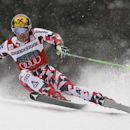 Marcel Hirscher of Austria clears a gate during his first run in the men's Alpine Skiing World Cup giant slalom in Garmisch-Partenkirchen March 1, 2015.     REUTERS/Wolfgang Rattay
