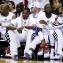 From left, Miami Heat's Ray Allen, Mario Chalmers, Dwyane Wade and Shane Battier sit on the bench in the second half of Game 2 of their NBA basketball playoff series in the Eastern Conference semifinals against the Chicago Bulls, Wednesday, May 8, 2013, in Miami. The Heat won 115-78. (AP Photo/Lynne Sladky)