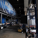 In this Oct. 15, 2014, photo, a security camera, upper right, has a view of part of MetLife Stadium, home of the New York Giants and the New York Jets football teams, in East Rutherford, N.J. From the command center, video operators can watch every nook