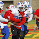 Buffalo Bills quarterback EJ Manuel (3) hands the ball to running back C.J. Spiller (28) during their NFL football training camp in Pittsford, N.Y., Sunday, July 20, 2014 The Associated Press