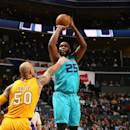 CHARLOTTE, NC - MARCH 3: Al Jefferson #25 of the Charlotte Hornets shoots against Robert Sacre #50 of the Los Angeles Lakers during the game at the Time Warner Cable Arena on March 3, 2015 in Charlotte, North Carolina. (Photo by Kent Smith/NBAE via Getty Images)