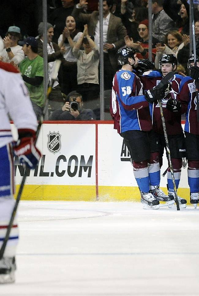 The Colorado Avalanche celebrate a goal by Avalanche left wing Gabriel Landeskog, of Sweden, against the Montreal Canadiens in the second period of an NHL hockey game on Saturday, Nov. 2, 2013, in Denver