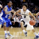 Colorado's Askia Booker (0) drives on Air Force's Kyle Green during the first half of their NCAA college basketball game, Sunday, Nov. 25, 2012, in Boulder, Colo. (AP Photo/The Daily Camera, Cliff Grassmick)