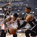 Toronto Raptors forward Amir Johnson, front left, battles with Brooklyn Nets' Paul Pierce, right, as Kevin Garnett, rear, defends during the first half of Game 2 in an NBA basketball first-round playoff series, Tuesday, April 22, 2014, in Toronto. (AP Photo/The Canadian Press, Frank Gunn)