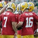 Green Bay Packers' Jordy Nelson huddles with the quarterbacks during NFL football training camp on Saturday, July 26, 2014, in Green Bay, Wis. (AP Photo/Morry Gash)