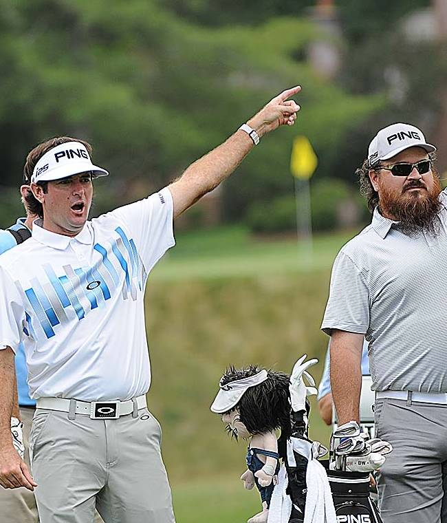 Jase Robertson, left, and Justin Martin, third from left, both with Duck Dynasty, and Bubba Watson, second from left, watch a ball hit Jim Justice during The Greenbrier Classic golf tournament in White Sulphur Springs, W.V., Wednesday, July 2, 2014