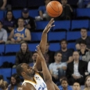 UCLA's Shabazz Muhammad (15) shoots over Washington forward Shawn Kemp Jr. (40) in the first half of an NCAA college basketball game in Los Angeles on Thursday, Feb. 7, 2013. (AP Photo/Reed Saxon)