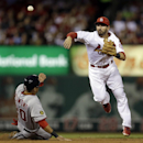 Washington Nationals' Ian Desmond, left, is out at second as St. Louis Cardinals shortstop Daniel Descalso turns the double play to end the top of the fourth inning of a baseball game Monday, Sept. 23, 2013, in St. Louis. Adam LaRoche was out at first The