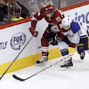 Phoenix Coyotes' Rob Klinkhammer (36) chases down a loose puck in front of St Louis Blues' Kevin Shattenkirk during the second period of an NHL hockey game Sunday, March 2, 2014, in Glendale, Ariz The Associated Press