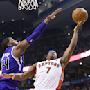 Toronto Raptors' Kyle Lowry, right, shoots on Sacramento Kings' Jason Thompson during first half NBA basketball action in Toronto on Friday, March 7 , 2014 The Associated Press