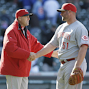 Cincinnati Reds manager Bryan Price, left, celebrates with closer Jonathan Broxton after they defeated the Chicago Cubs 4-1 in a baseball game in Chicago, Friday, April 18, 2014 The Associated Press