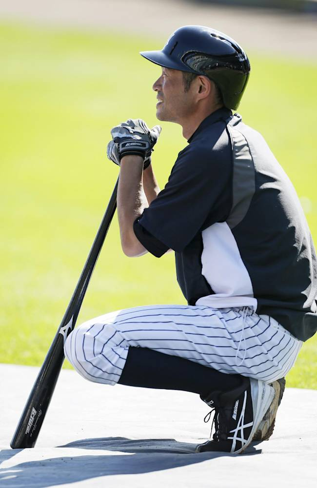 New York Yankees right fielder Ichiro Suzuki waits to take batting practice before an exhibition baseball game against the Washington Nationals Monday, March 3, 2014, in Tampa, Fla