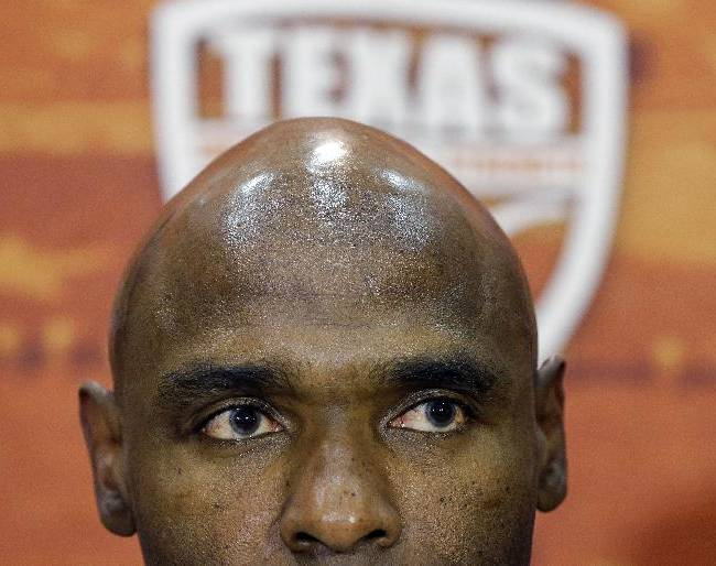 Charlie Strong listens to a question during a news conference where he was introduced as the new Texas football coach, Monday, Jan. 6, 2014, in Austin, Texas. Strong acknowledged the historical significance of being the school's first African-American head coach of a men's sport. He takes over for Mack Brown, who stepped down last month after 16 seasons