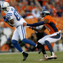 Indianapolis Colts wide receiver Reggie Wayne (87) is stopped by Denver Broncos cornerback Aqib Talib (21) during the first half of an NFL football game, Sunday, Sept. 7, 2014, in Denver The Associated Press