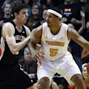 Tennessee forward Jarnell Stokes (5) works against Mercer forward Daniel Coursey during the first half of a first-round game in the NIT college basketball tournament Wednesday, March 20, 2013, in Knoxville, Tenn. (AP Photo/Wade Payne)