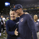 Seattle Seahawks coach Pete Carroll, left, and Chicago Bears coach Marc Trestman meet on the field after the Seahawks' 34-6 win in a preseason NFL football game, Friday, Aug. 22, 2014, in Seattle The Associated Press