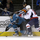 San Jose Sharks' Tommy Wingels, left, collides with a linesman and Washington Capitals' Dmitry Orlov (81), of Russia, during the first period of an NHL hockey game on Saturday, March 22, 2014, in San Jose, Calif The Associated Press