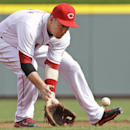 Cincinnati Reds third baseman Todd Frazier fields a ground ball hit by St. Louis Cardinals' Allen Craig in the first inning of a baseball game, Monday, March 31, 2014, on opening day in Cincinnati. Frazier threw Craig out at first The Associated Press