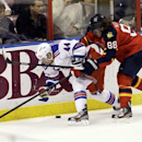 New York Rangers' Steve Eminger (44) and Florida Panthers' Peter Mueller (88) battle for the puck during the second period of